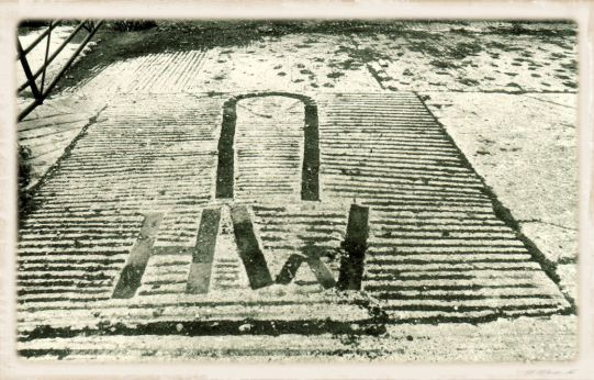 4_HW's owl and initials set in brick in the yard2